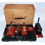 A scratch built miniature live steam boiler comprising of tin housed copper boiler with safety valve