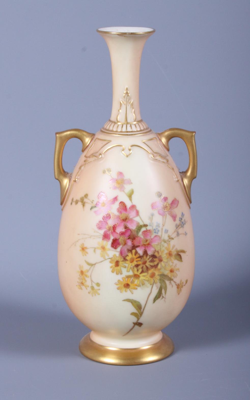 Lot 41 - A late Victorian Royal Worcester blush ivory two-handled porcelain vase, shape number 1762,