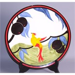 A Clarice Cliff centenary limited edition plate, 325/1999, and a Goebel's figure group after