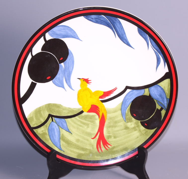 Lot 6 - A Clarice Cliff centenary limited edition plate, 325/1999, and a Goebel's figure group after