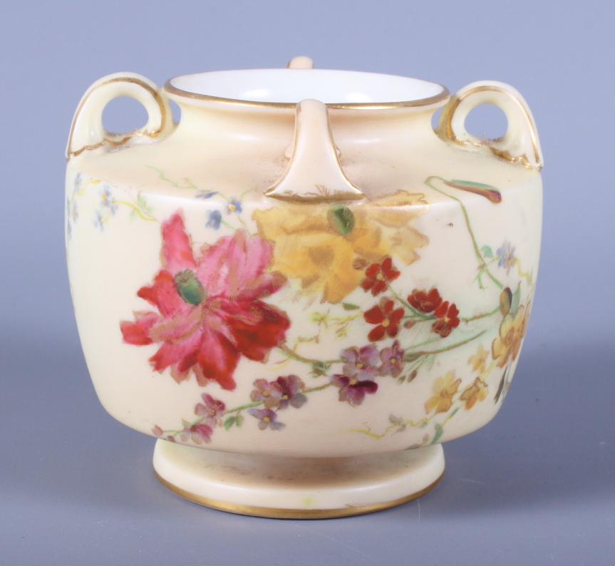 Lot 36 - An early 20th century Royal Worcester blush ivory porcelain vase, shape number 991, with four lug