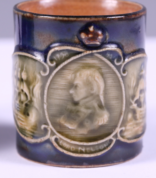 Lot 42 - A miniature Royal Doulton stoneware jug, applied with a plaque of the profile of Lord Nelson,