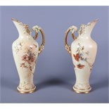 A matched pair of late Victorian Royal Worcester blush ivory porcelain ewers, shape number 1587,