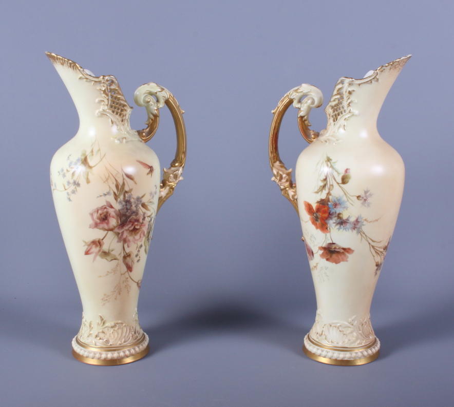 Lot 33 - A matched pair of late Victorian Royal Worcester blush ivory porcelain ewers, shape number 1587,