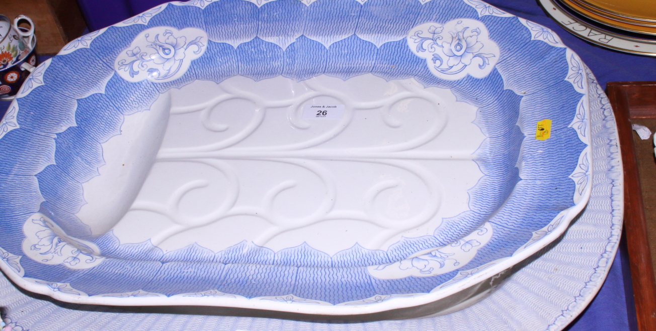 Lot 26 - A late Victorian blue and white pottery meat plate, bearing impressed marks to base, together with a