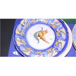 "An 18th century Continental polychrome Delftware dish with bird and fruit decoration, 12 1/4"" dia ("