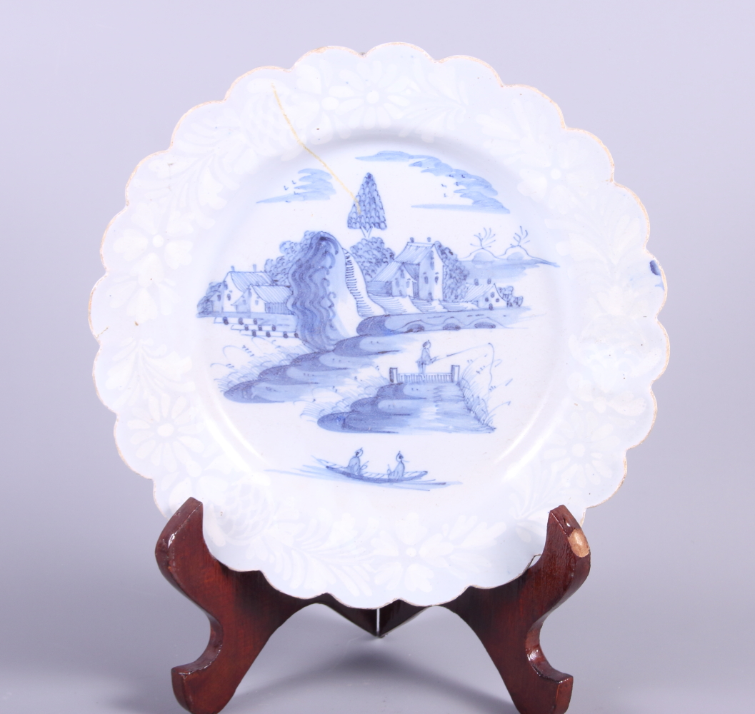 An early 18th century Bristol bianca sopra plate with waived rim and landscape with fisherman