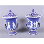 A pair of late Victorian blue and white Wedgwood jasperware (cameo ware) two-handled urns, each with
