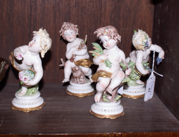 "Lot 47 - A set of four Capodimonte figures of cherubs representing ""The Seasons"", 6"" high"
