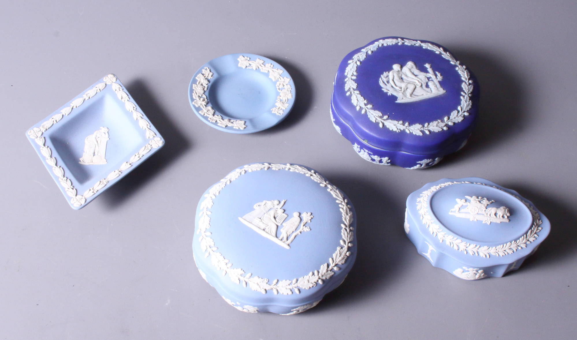 Lot 40 - Five pieces of mid 20th century Wedgwood jasperware, including three trinket boxes and two pin