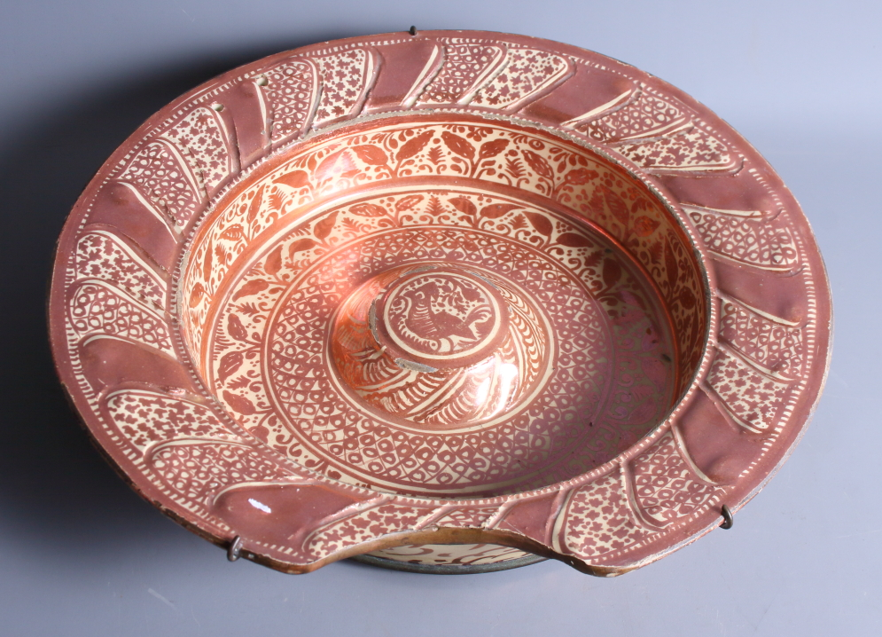"""Lot 2 - An early 18th century Hispano Moresque shaving bowl with traditional design, 14"""" dia (restorations)"""