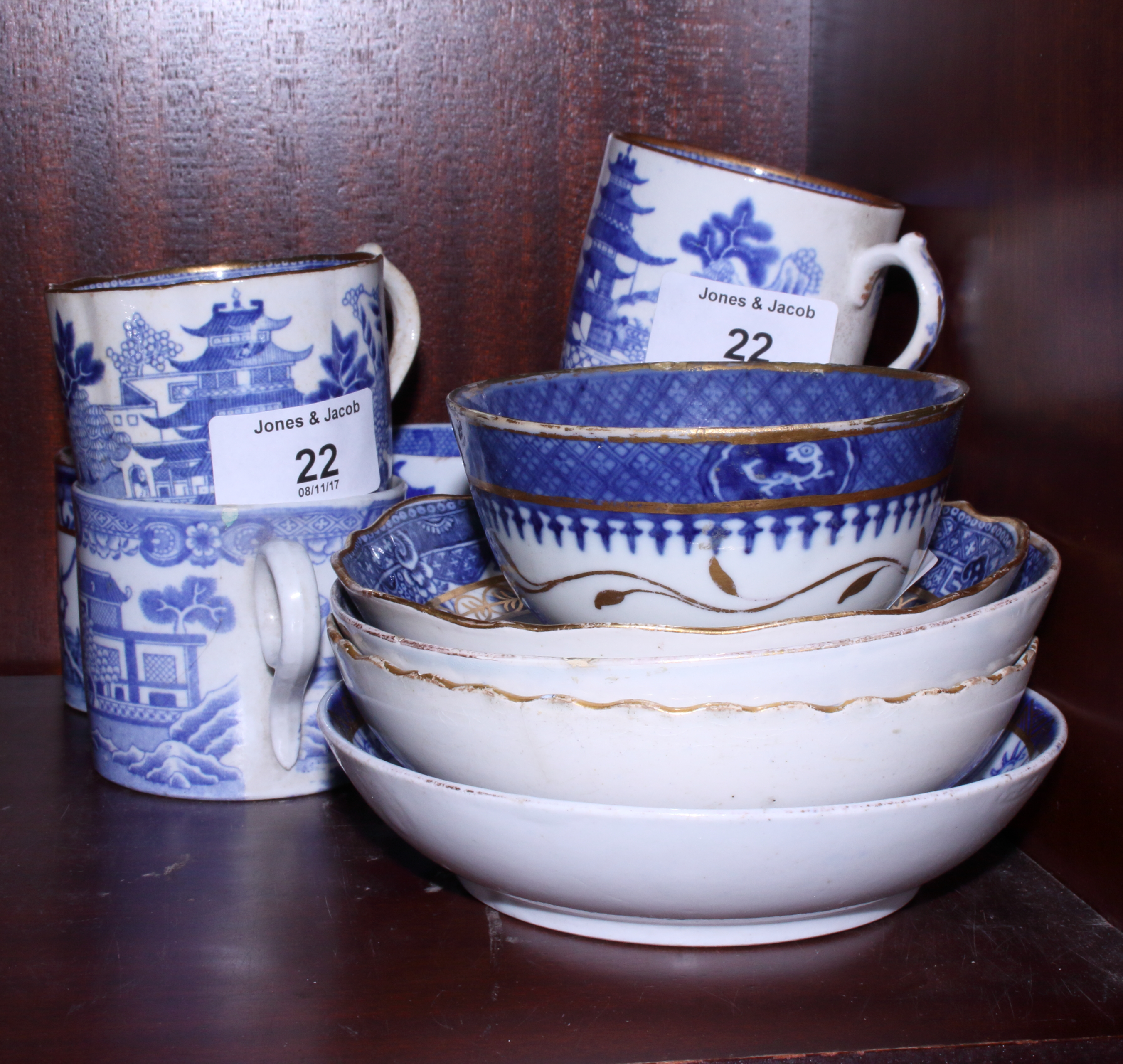 Lot 22 - A group of early 19th century English blue and white coffee cans and saucers, various, including