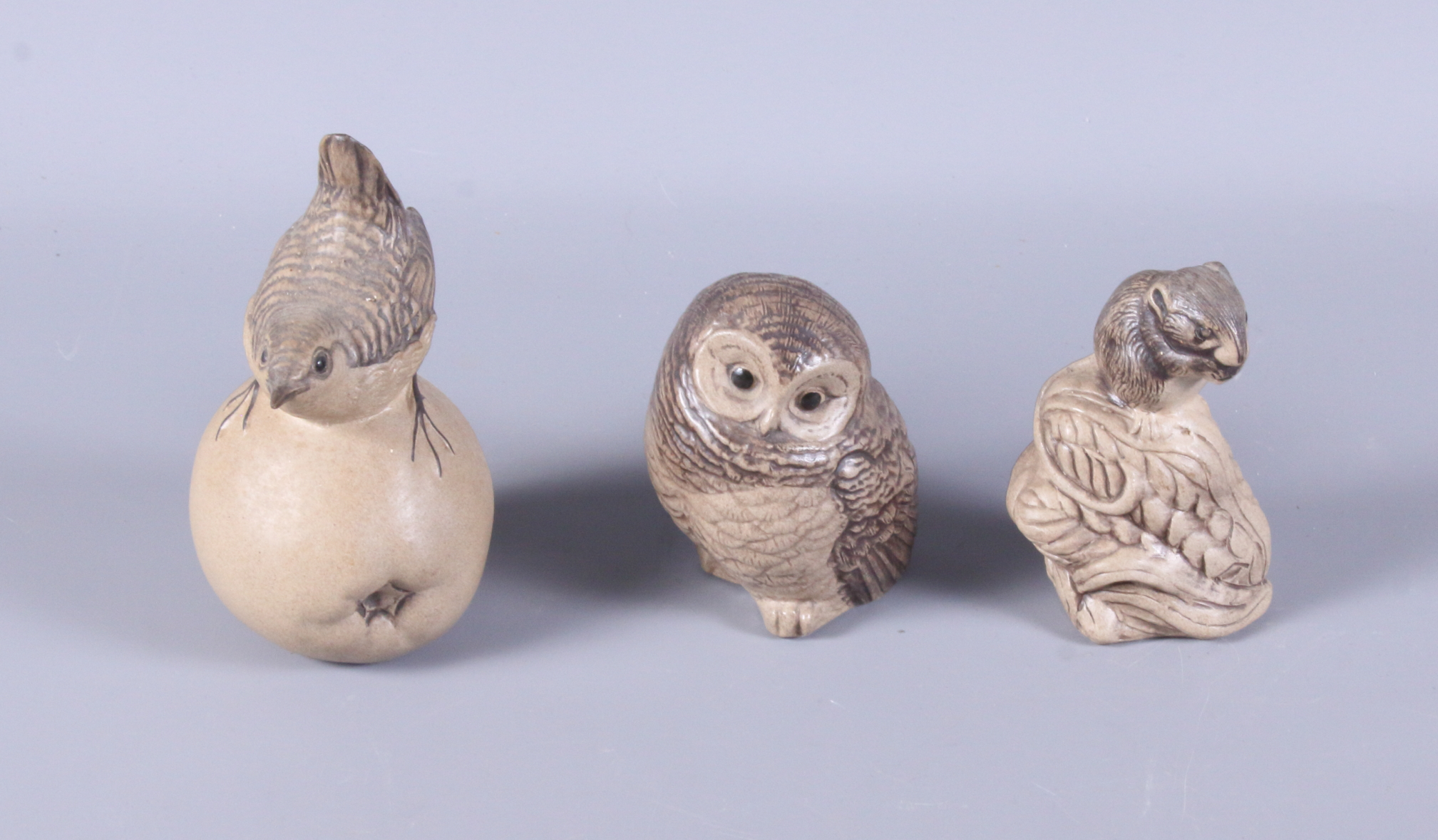 Lot 37 - Three Poole Pottery stoneware models, wren on an apple, standing owl, and mouse on an ear of corn