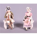 A pair of late 19th century Continental porcelain figures, seated musician and a woman in period