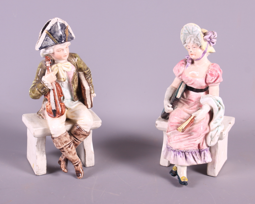 Lot 29 - A pair of late 19th century Continental porcelain figures, seated musician and a woman in period