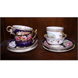 Four 19th century porcelain cups and saucers including Coalport, decorated with flowers on a