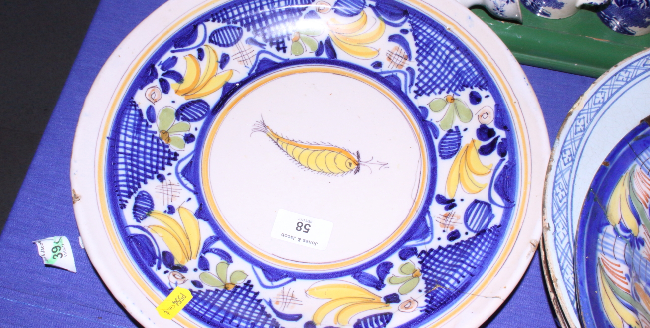 "Lot 58 - An 18th century Continental polychrome Delftware dish with bird and fruit decoration, 12 1/4"" dia ("