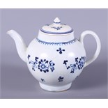 A 19th century Liverpool porcelain globular-shaped teapot, decorated with sprigs of flowers, 7 1/