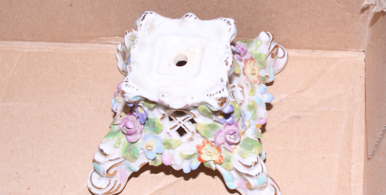 """Lot 27 - A pair of 19th century Continental porcelain floral encrusted candlesticks, 9 1/2"""" high"""