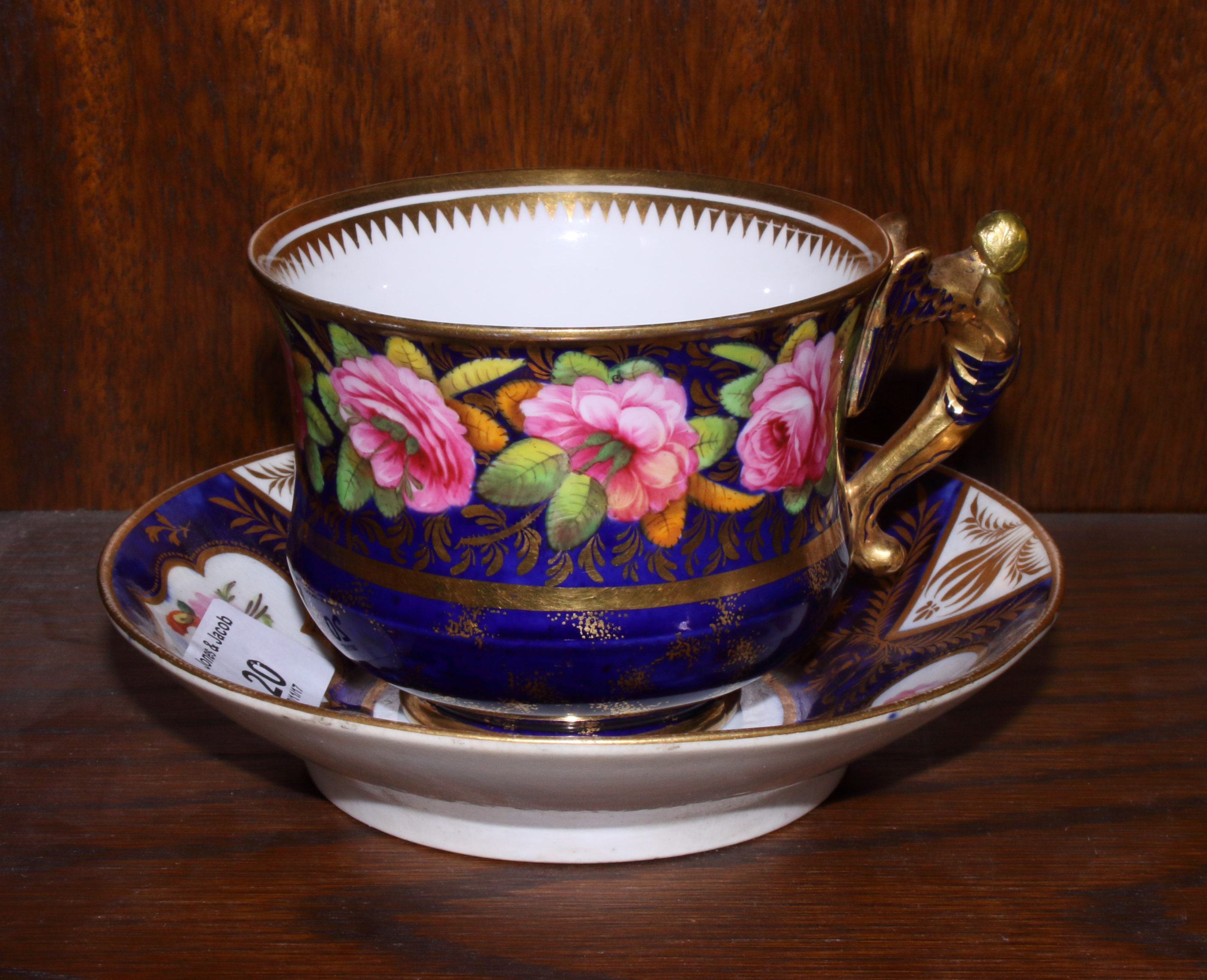 Lot 20 - Four 19th century porcelain cups and saucers including Coalport, decorated with flowers on a