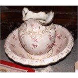 A Victorian floral transfer decorated toilet jug and bowl and a wooden table lamp, carved man