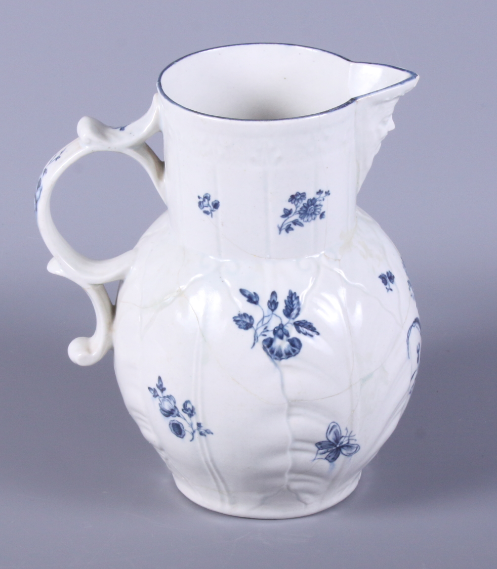 Lot 15 - A 19th century blue and white Worcester cabbage jug, decorated with sprigs of flowers and