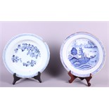 "An 18th century Delftware plate with chinoiserie decoration, 12"" dia (restored) and a similar dish"