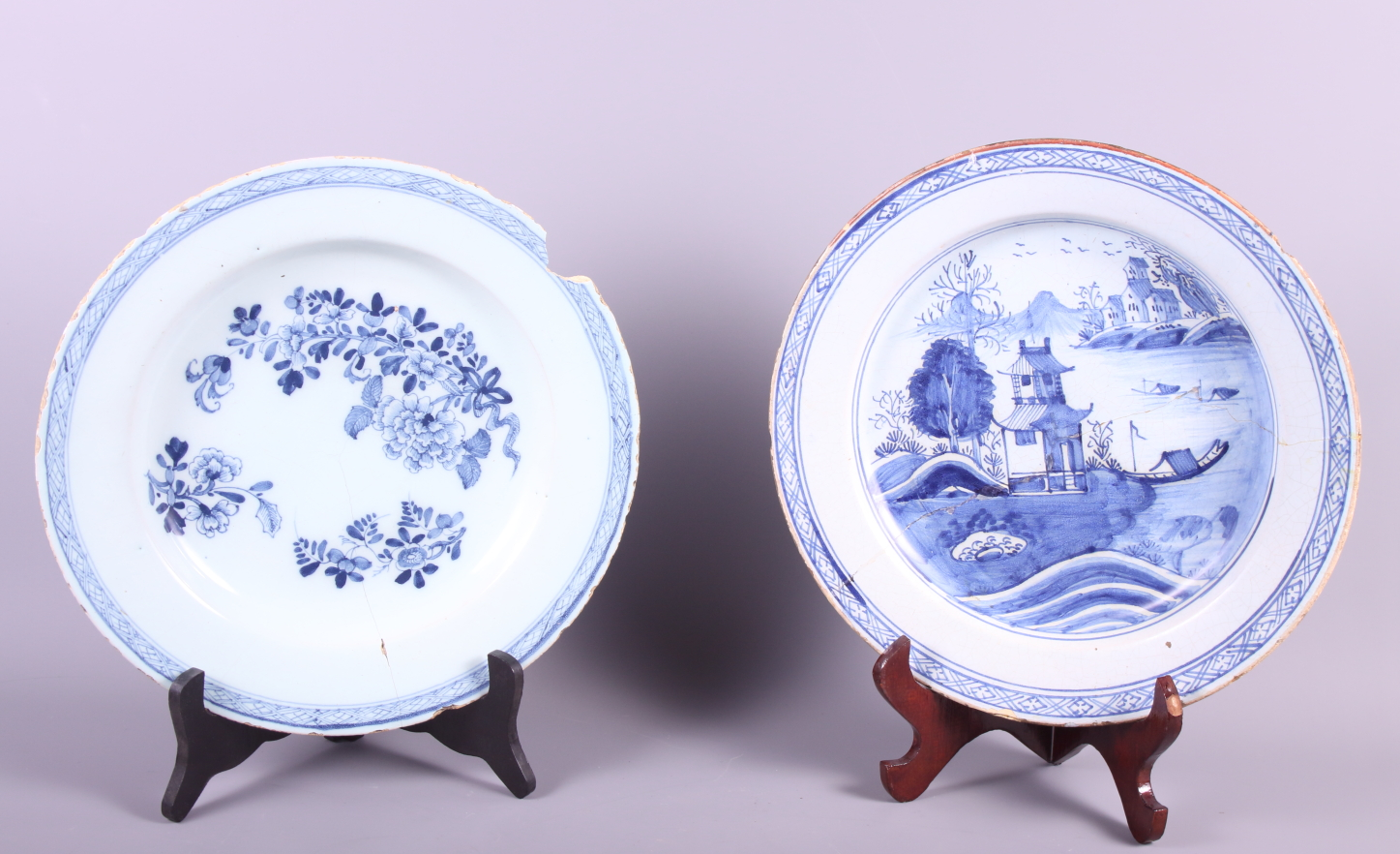 "Lot 57 - An 18th century Delftware plate with chinoiserie decoration, 12"" dia (restored) and a similar dish"