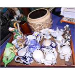 A Bretby jardiniere, decorated dragons, a Carlton ware sauce boat, assorted jugs and other items