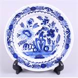 "An 18th century English delft dish, decorated with flowers and fence, 9"" dia"