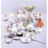 A Metzler and Ortloff figure of a young child, a centrepiece decorated cherubs, various figures,