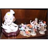 """A Lladro model of a clown, on wooden stand, 13"""" high overall, two Capodimonte figure groups and"""