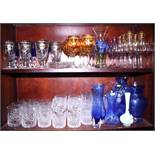 A quantity of glassware, including wines with gilt rim, champagne flutes, whisky tumblers, blue