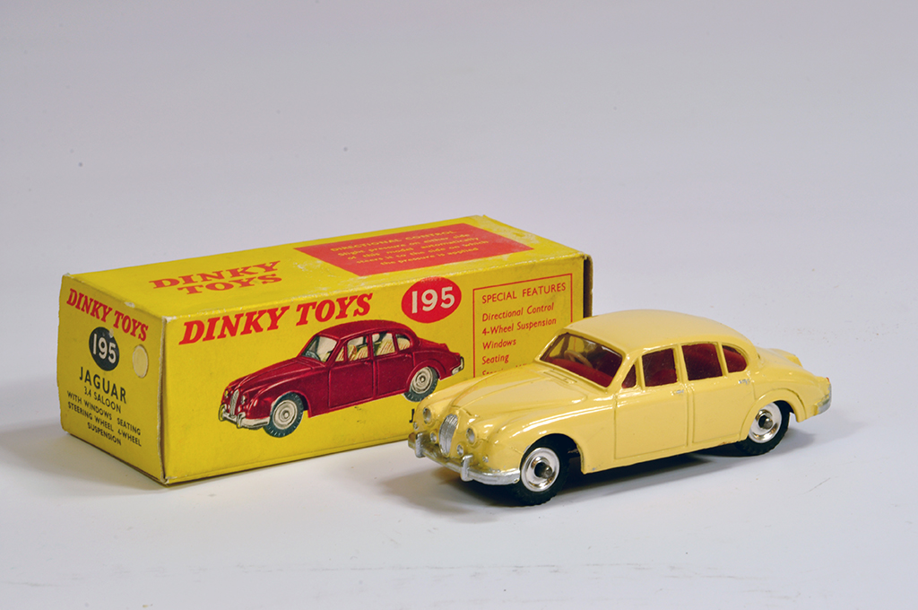 Lot 16 - Dinky No. 195 Jaguar 3.4 Saloon with cream body. NM in E Box.