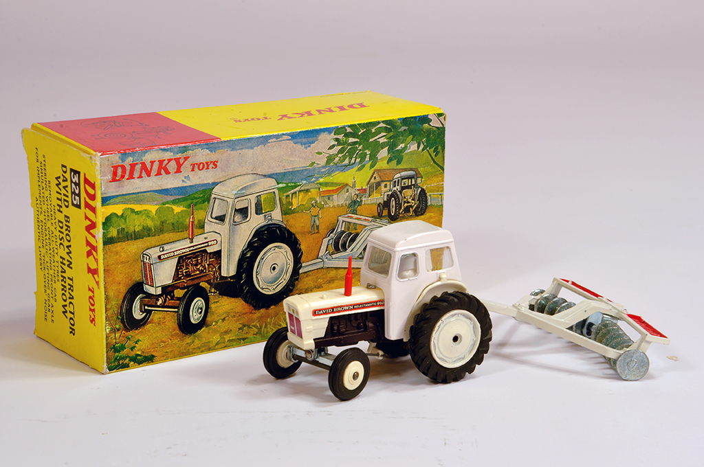 Lot 2 - Dinky No. 325 David Brown Tractor with Disc Harrow. A fine example is NM in E Box.