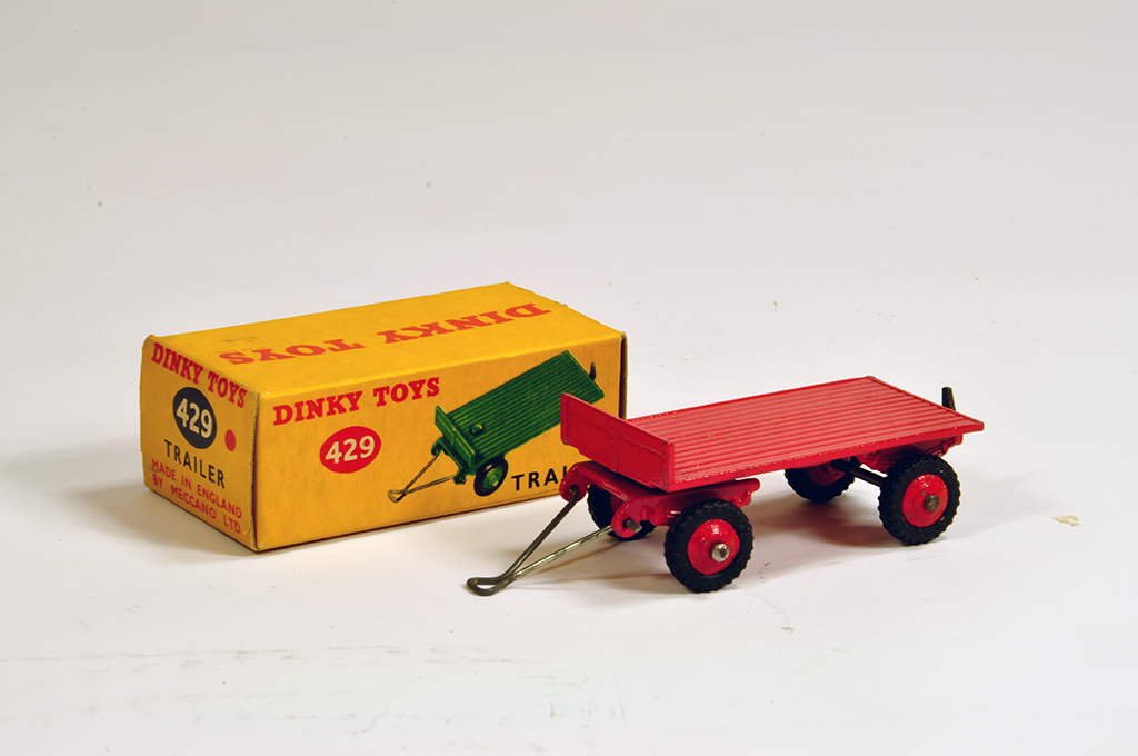 Lot 12 - Dinky No. 429 Trailer in red including ridged hubs with black treaded tyres. E to NM in VG Box.