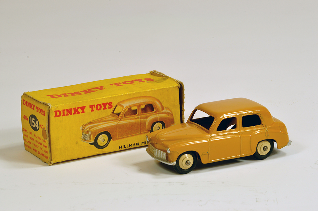 Lot 15 - Dinky No. 154 (40f) Hillman Minx Saloon with dark tan body. E to NM in G Box (missing end flap).