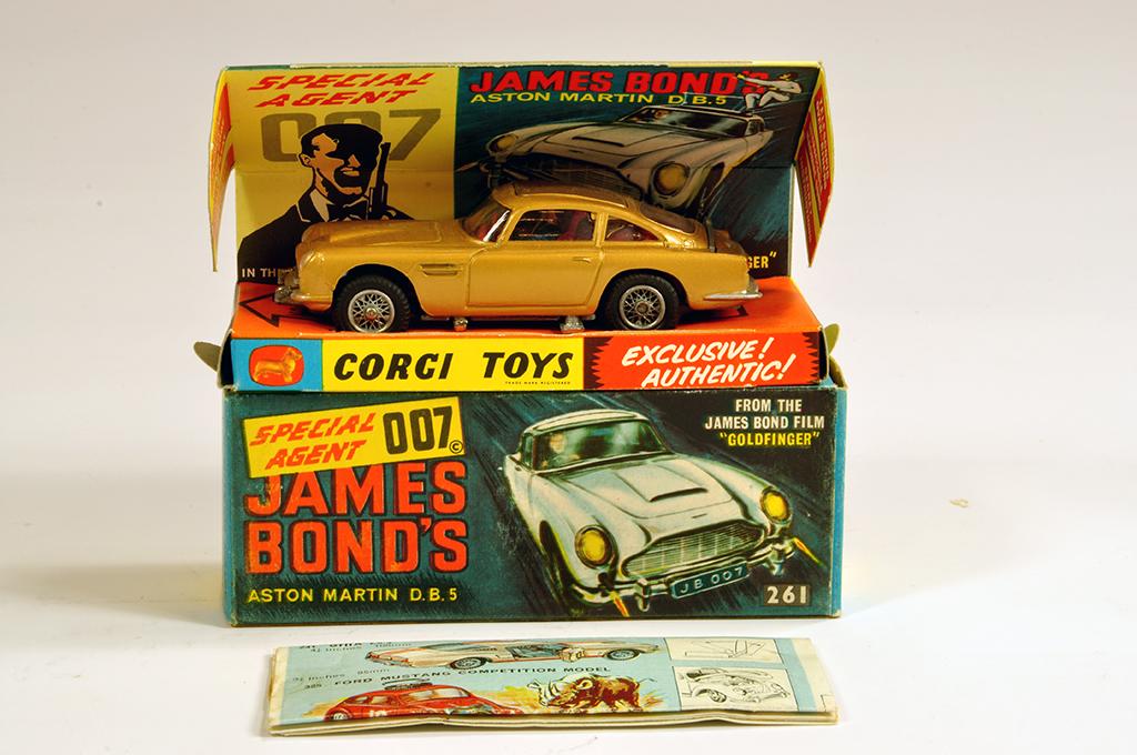 Lot 37 - Corgi No. 261 James Bond's Aston Martin DB5 in Rarer Gloss Gold. Fine example is NM in E Box.