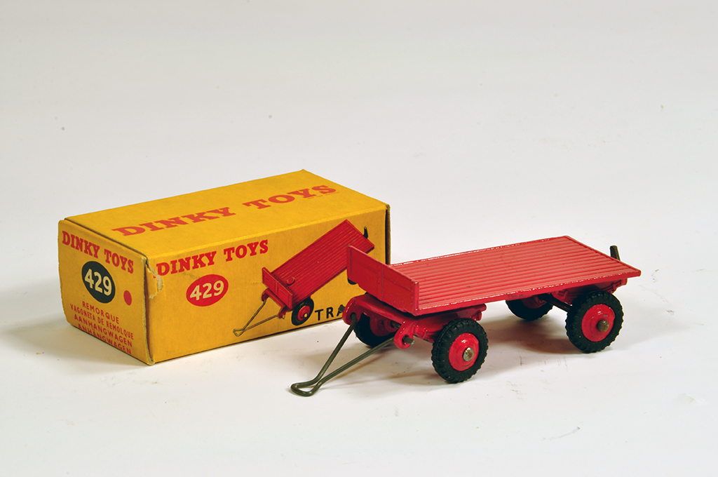Lot 10 - Dinky No. 429 Trailer in red including ridged hubs with black treaded tyres. E to NM in VG Box.
