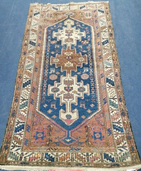 Lot 942 - A Persian blue ground rug, 195 x 97cm