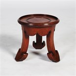 A Chinese dark wood vase stand, the circular top raised on three concave supports with ruyi carved