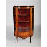 An early 20th century Louis XV style kingwood, marquetry and gilt metal mounted corner vitrine,