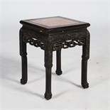A Chinese dark wood jardiniere stand, Qing Dynasty, the square top with a mottled red and white