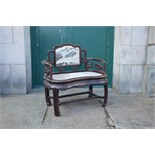 A Chinese dark wood and marble armchair, Qing Dynasty, the rectangular panelled back with grey and