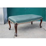 A Victorian mahogany stool, the green striped upholstered seat raised on four scroll
