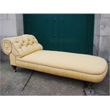 A Victorian mahogany chaise longue, the button down upholstered back and stuffover seat raised on