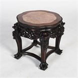 A Chinese dark wood jardiniere stand, late Qing Dynasty, the shaped circular top with a mottled