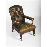 A Victorian mahogany green leather upholstered armchair, with button down upholstered back, arms and