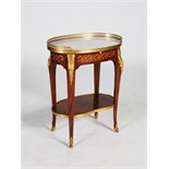 A 20th century French mahogany, marquetry and ormolu mounted occasional table, the oval shaped white