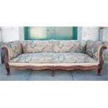A 19th century rosewood sofa, the needlework upholstered back, arms and seat fronted by scroll and